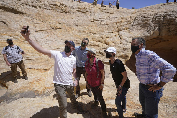 Utah Gov. Spencer Cox takes a selfie with Rep. Blake Moore, U.S. Interior Secretary Deb Haaland, Lt. Gov. Deidre Henderson and Sen. Mitt Romney. The group toured ancient dwellings along the Butler Wash trail at the Bears Ears National Monument near Blanding.