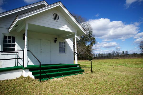 Green astroturf leads from the lawn onto the Harmony Presbyterian Church front steps in Manning, South Carolina.