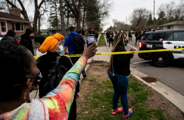 People gather to protest the police Sunday in Brooklyn Center, Minn., after an officer shot Daunte Wright during a traffic stop.