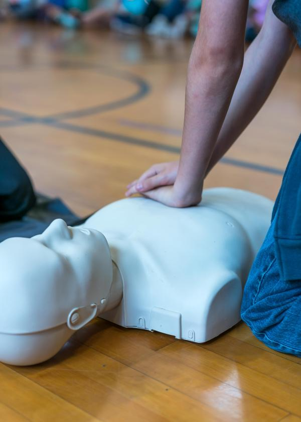 A student performs chest compressions on a mannequin in this photo provided by the American Heart Association.