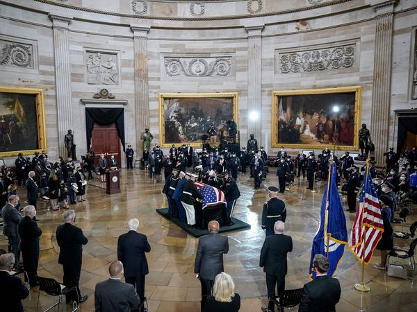 "The casket of the late U.S. Capitol Police Officer William ""Billy"" Evans arrives for a memorial service Tuesday in the Rotunda of the U.S. Capitol."