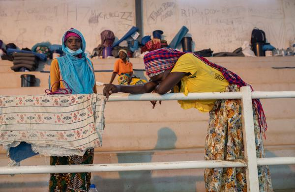 People fleeing Palma gather in a sports center in the town of Pemba, 250 miles south of Palma on April 2. Many have seen friends and family beheaded or shot and their homes burned.