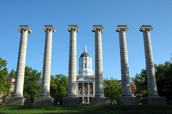 Architectural columns and Jesse Hall on the campus of University of Missouri.