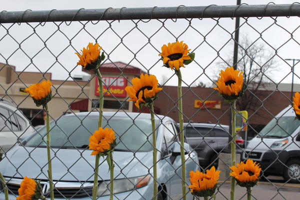 Flowers left at a memorial outside the King Soopers in Boulder that was the site of Monday's mass shooting.