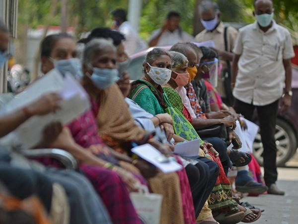 People wait for their turn to receive the COVID-19 vaccine at a government hospital in Chennai, India, on Friday.
