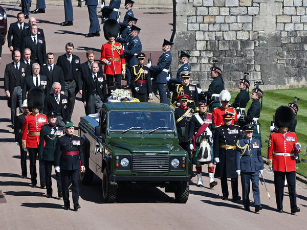 Members of the royal family follow Prince Philip's coffin during the ceremonial procession during his funeral at Windsor Castle on Saturday in Windsor, England.