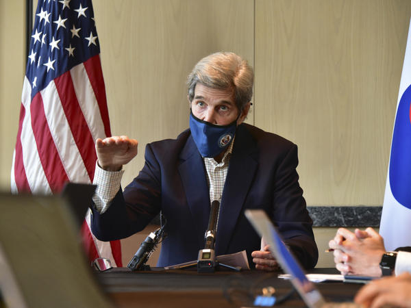 U.S. special envoy for climate John Kerry speaks during a roundtable meeting with reporters in Seoul on Sunday. The United States and China have agreed to cooperate with other countries to curb climate change, just days before a virtual summit of world leaders to discuss the issue.