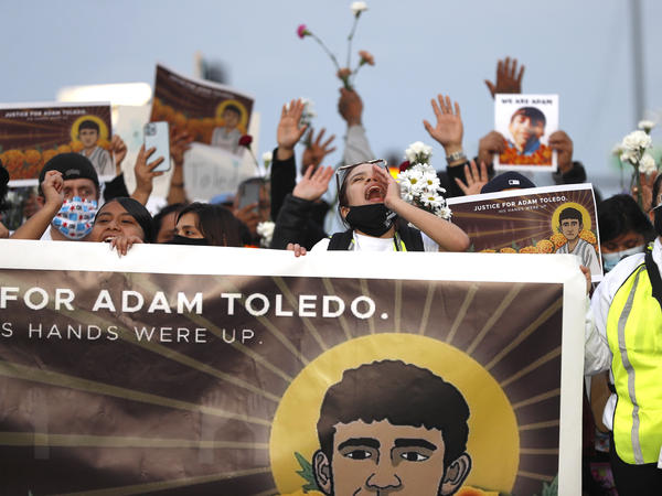 Demonstrators attend a peace walk on Sunday honoring the life of 13-year-old Adam Toledo in Chicago's Little Village neighborhood.
