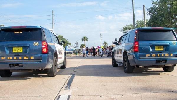 Officers from the St. Augustine Police Department stopped traffic along U.S. 1 as scores of Northeast Florida residents marched to protest the death of George Floyd at the hands of police in Minneapolis, Minnesota (June 1, 2020).