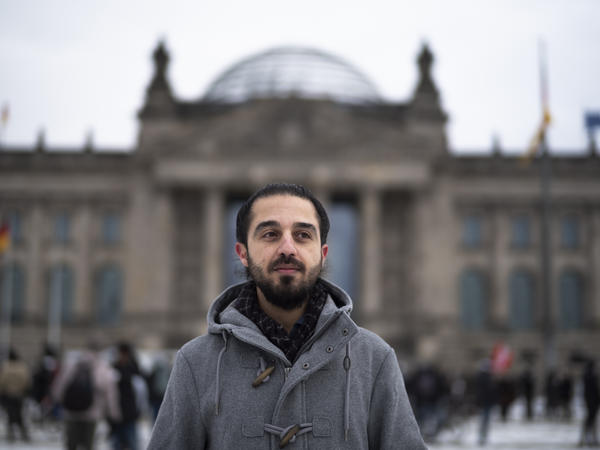 Tareq Alaows stands in front of the Reichstag in Berlin. Alaows came to Germany as an asylum-seeker in 2015 and launched his campaign to run in Germany's federal election in September for the Green Party, but recently withdrew.