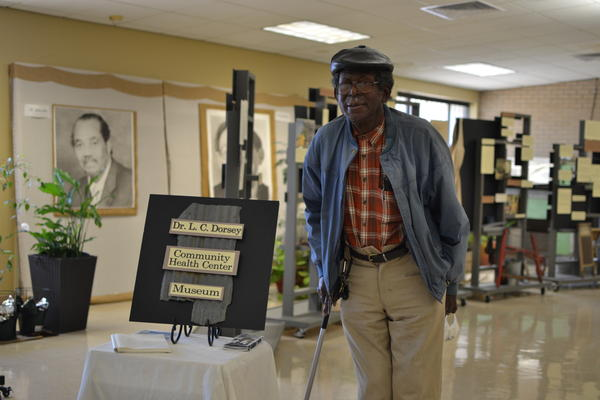 Mitch Williams, 85, one of the first patients to be seen at the Delta Health Center in Mound Bayou, Miss. poses inside of the center's museum, March 3, 2021.