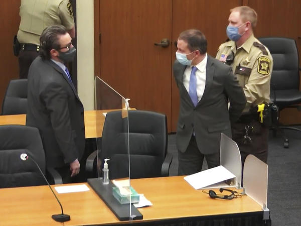 Former Minneapolis police officer Derek Chauvin is taken into custody as his attorney, Eric Nelson, looks on after the verdicts were read on Tuesday at Chauvin's trial for the 2020 death of George Floyd.