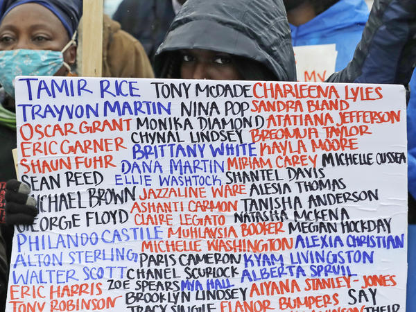 A sign at a June 2020 protest against racial injustice and police violence in Seattle bears the names of people killed by police.