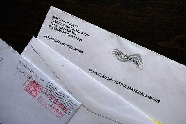 A set of ballots and secrecy and mailing envelopes.