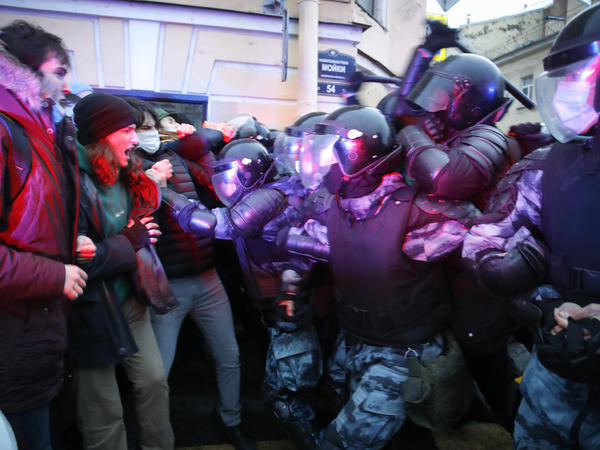 People clash with police during a protest in support of jailed opposition leader Alexei Navalny in St. Petersburg, Russia, on Wednesday. A human rights group that monitors political repression said at least 1,700 people were arrested across the country in connection with the protests.