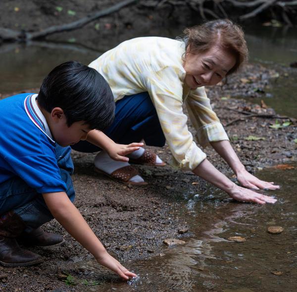 In the film <em>Minari, </em>Soonja develops a special bond with her grandson David, played by Alan Kim.