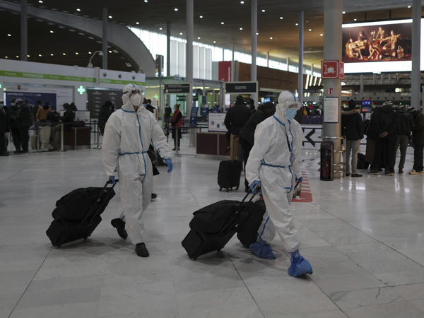 Global travel continues to be risky because of the coronavirus. Earlier this year, passengers from Taiwan wear protective gear as they arrive at France's Charles de Gaulle Airport, and just this week, the U.S. issued over 100 new travel advisories.