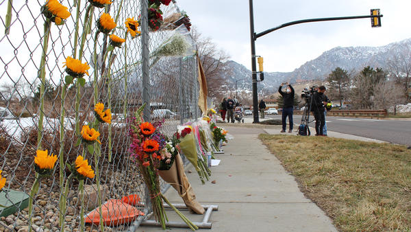 Flowers left at a memorial outside the King Soopers in Boulder where 10 people died in a mass shooting on Monday, March 22.
