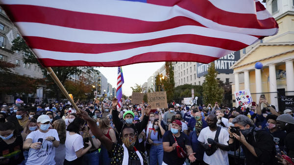 People gather in Black Lives Matter Plaza to celebrate president-elect Joe Biden's win over President Donald Trump on Nov. 7 in Washington, D.C. A new Harvard poll shows the youngest voting-age Americans are more politically active and optimistic about the future than four years ago.