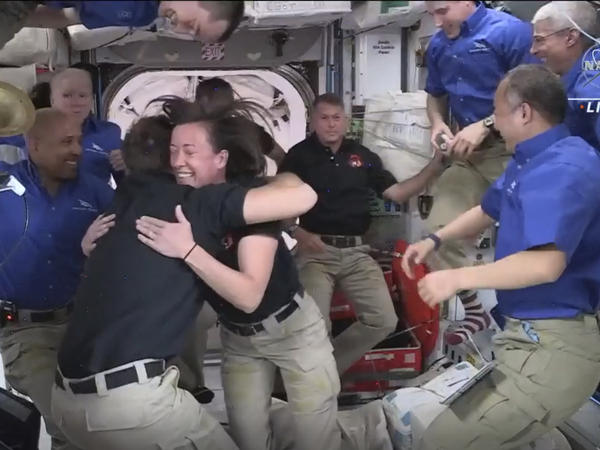 In this image provided by NASA, SpaceX astronauts are greeted by those already aboard the International Space Station after the Dragon capsule successfully docked on Saturday. Their arrival brings the total number of astronauts on the station to a recent high of 11.