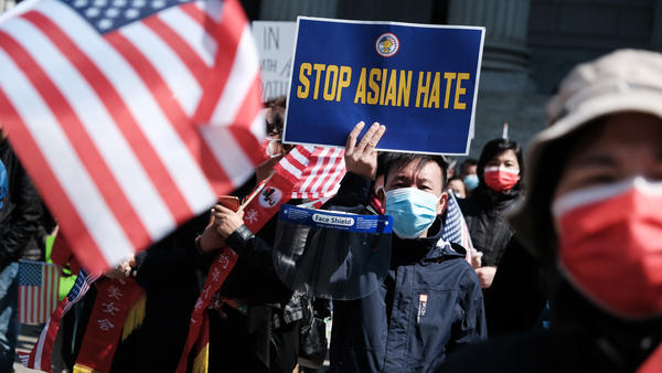 People participate in a protest to demand an end to anti-Asian violence on April 4 in New York City. In a new incident, an Asian man was attacked in New York City on Friday.