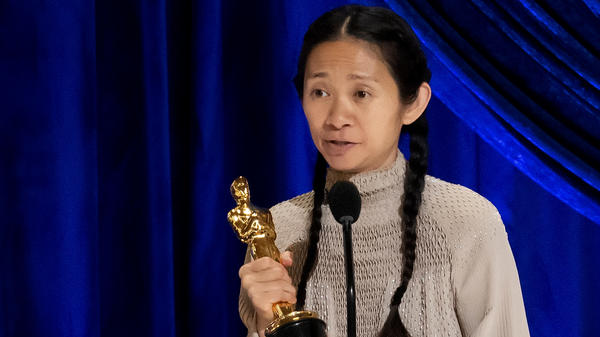 Chloé Zhao accepts the Oscar for best director during Sunday night's ceremony. Her film <em>Nomadland </em>also won best picture.