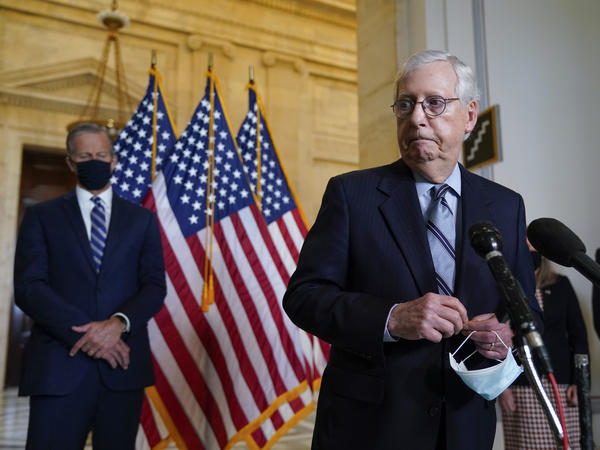 Senate Minority Leader Mitch McConnell, R-Ky., joined by Senate Minority Whip John Thune, R-S.D., left, has argued that President Biden is not governing like the moderate he campaigned as in 2020.