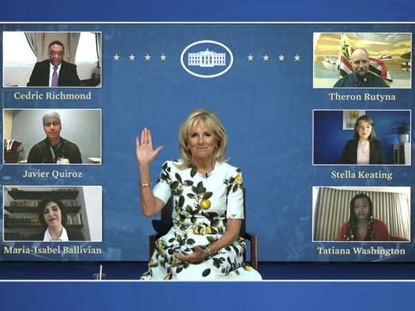 An image from video provided by the White House shows first lady Jill Biden meeting with her virtual guests ahead of President Biden's joint address on Wednesday. Many Democratic lawmakers are also naming guests of honor, who will be watching the speech remotely.