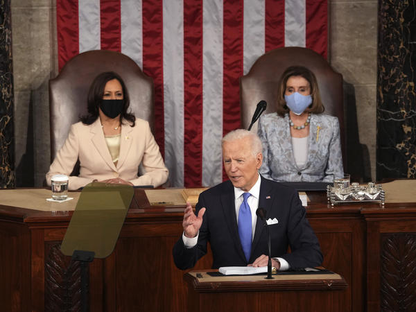 President Biden speaks to a joint session of Congress on Wednesday in the House Chamber at the U.S. Capitol, as Vice President Harris and House Speaker Nancy Pelosi watch.
