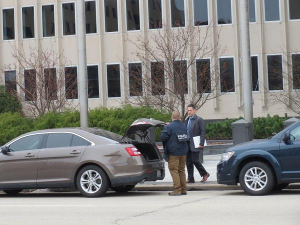 Federal agents load documents into a car taken from Caterpillar's then-world headquarters on Adams Street in downtown Peoria on March 2, 2017.