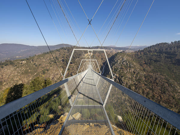 The 516 Arouca, the longest pedestrian suspension bridge in the world, hangs above the Aguieiras Waterfall in the Paiva Gorge in Arouca, Portugal. It is opening to the public next week.