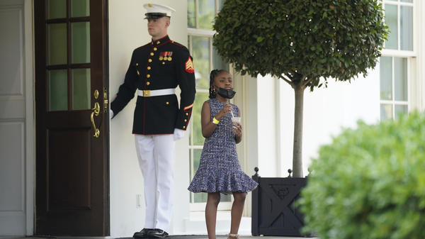Gianna Floyd, George Floyd's daughter, walks out of the West Wing door at the White House after meeting Tuesday with President Biden and Vice President Harris.