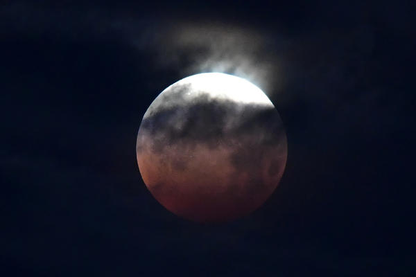 The lunar eclipse is seen in Santa Monica. Full moons that occur in May are sometimes known as flower moons.