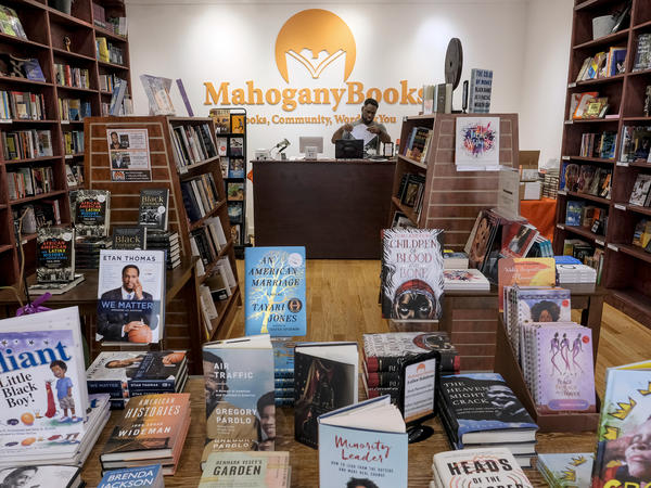 """Derrick Young, co-owner of Mahogany Books in Washington, D.C., says his store has seen new customers in the last year who seem to be """"willing to do the work"""" to educate themselves on issues of race in America."""
