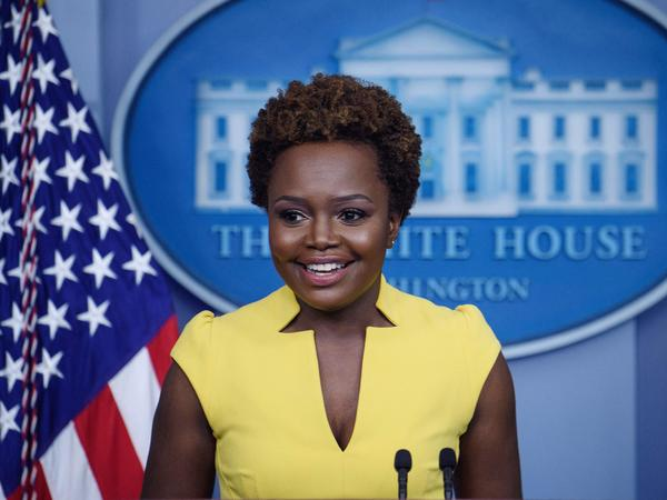 """White House principal deputy press secretary Karine Jean-Pierre arrives for the press briefing Wednesday. """"I believe being behind this podium, being in this room, being in this building, is not about one person,"""" she said of the historic nature of her turn in the briefing room."""