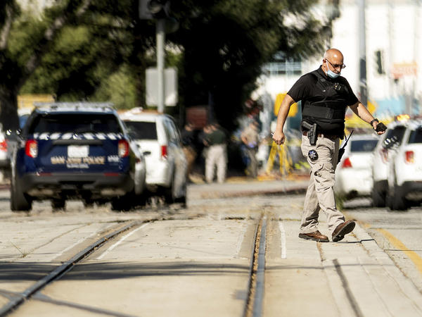 Law enforcement officers respond to a mass shooting at a Santa Clara Valley Transportation Authority facility on Wednesday in San Jose, Calif. A Santa Clara County sheriff's spokesman said the rail yard shooting left multiple people, including the shooter, dead.