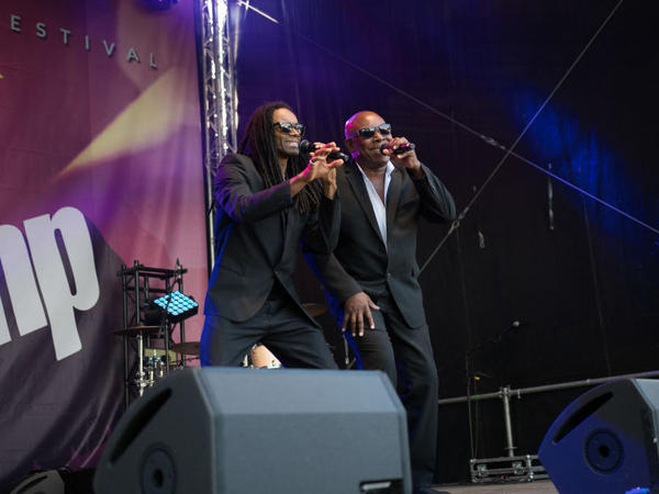 """John Davis (right), onstage with former Milli Vanilli star Fabrice """"Fab"""" Morvan, in Eisenach, Germany, in 2018."""