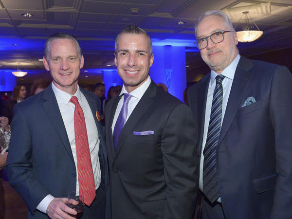 A Martínez (center) has been named a new co-host for NPR's <em>Morning Edition</em>. He is shown with Southern California Public Radio CEO Herb Scannell (right) at a fundraising gala for KPCC in March 2019.
