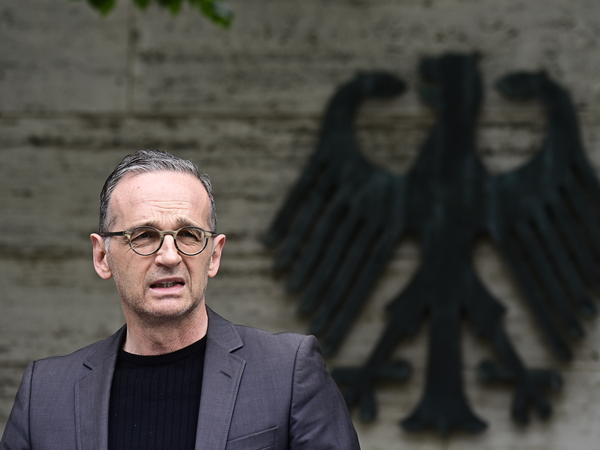 German Foreign Minister Heiko Maas addresses the media Friday in Berlin. Germany has reached an agreement with Namibia that will see it officially recognize as genocide the colonial-era killings of tens of thousands of people and commit to spending $1.3 billion, largely on development projects.