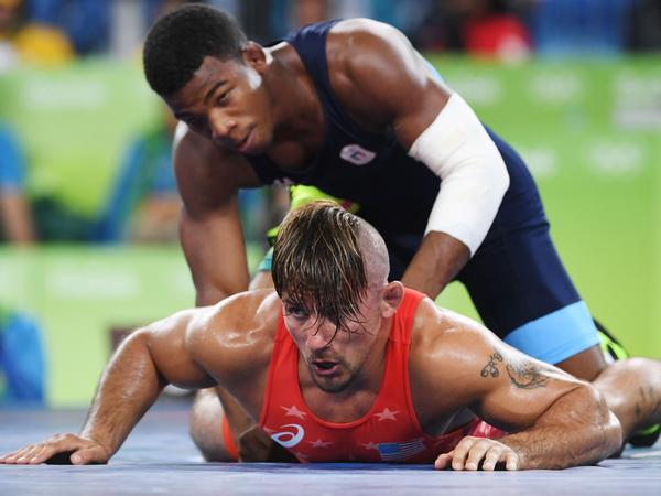 U.S. wrestler Frank Molinaro (red) battles Italy's Frank Chamizo Marquez in the 65-kg (143 pound) bronze medal bout at the 2016 Summer Olympics in Rio de Janeiro. Molinaro, who lost to Marquez, recently retired from the sport when the 2020 Olympics were postponed for a year because of the coronavirus outbreak.