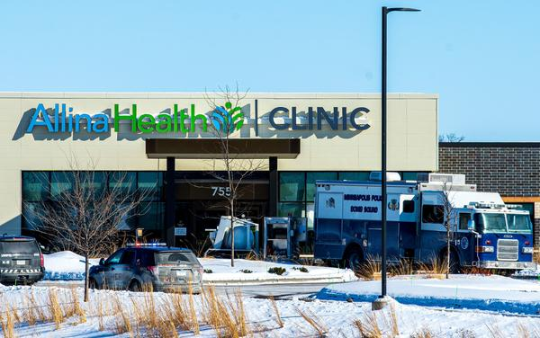 Police investigate the scene at Allina Health Clinic in Buffalo, Minn., on Tuesday after a shooting there.