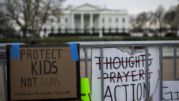 Signs sit near the White House following a 2018 March for Our Lives rally. Three years later, the activist group, founded by survivors of the deadly shooting at Marjory Stoneman Douglas High School in Florida, is consulting with the Biden administration on violence prevention policies.