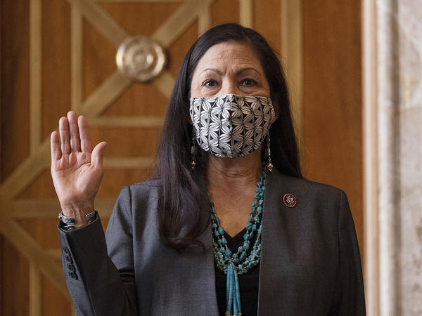 Rep. Deb Haaland, D-N.M., is sworn in before her Senate confirmation hearing to be interior secretary last month. Her confirmation makes her the United States' first Native American Cabinet secretary.