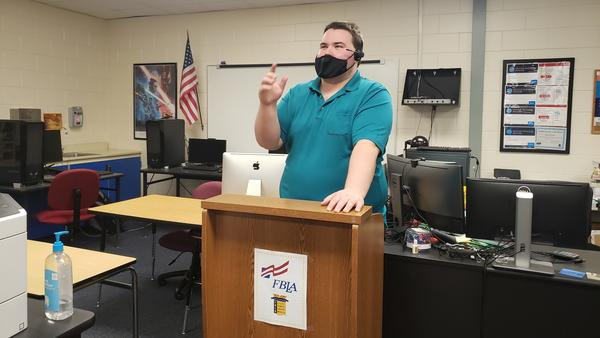"""Jason Felt teaches a cybersecurity class at Countryside High School in Clearwater, Fla. The group Cyber Florida has helped organize the program in many parts of the state, and is planning to expand its """"digital literacy"""" campaign to include topics like disinformation."""