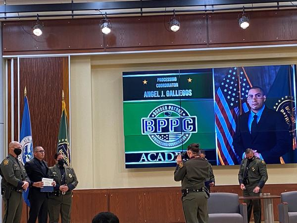 The recent graduation ceremony for the Border Patrol's processing coordinator program. The people in these new positions will be assigned to work inside stations to care for individuals whom Border Patrol agents apprehend.