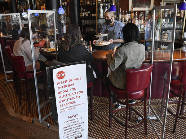 Diners eat lunch at Max's Oyster Bar in West Hartford, Conn., on March 19. Retail sales surged last month as $1,400 relief payments and easing coronavirus restrictions led shoppers to open their wallets.