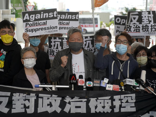 Pro-democracy activist Lee Cheuk-yan, center, arrives at a court in Hong Kong Friday.  Seven of Hong Kong's leading pro-democracy advocates, including Lee, and pro-democracy media tycoon Jimmy Lai, were sentenced Friday for organizing a march during the 2019 anti-government protests.
