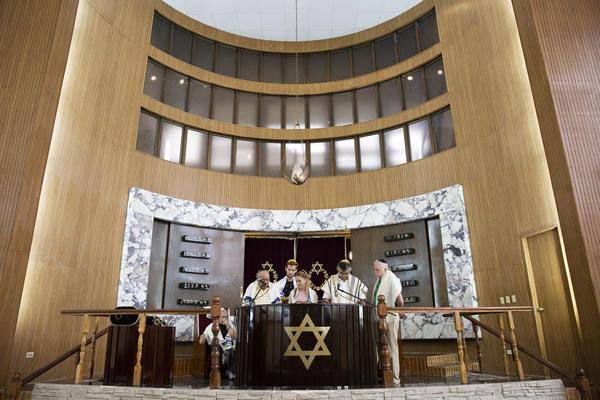 Adri Quiñones, center, leads the prayer during Saturday morning Shabbat services at Beth Shalom on Jan. 18, 2020.