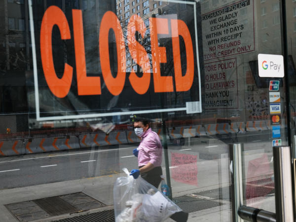 A closed sign is displayed in the window of a business in a nearly deserted lower Manhattan on April 17, 2020, in New York. Many small businesses benefited from a government emergency loan program during the pandemic, but its effectiveness is still in doubt.
