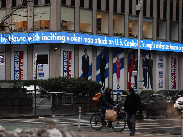 News headlines on the impeachment trial of Donald Trump are displayed outside Fox headquarters in February in New York City.